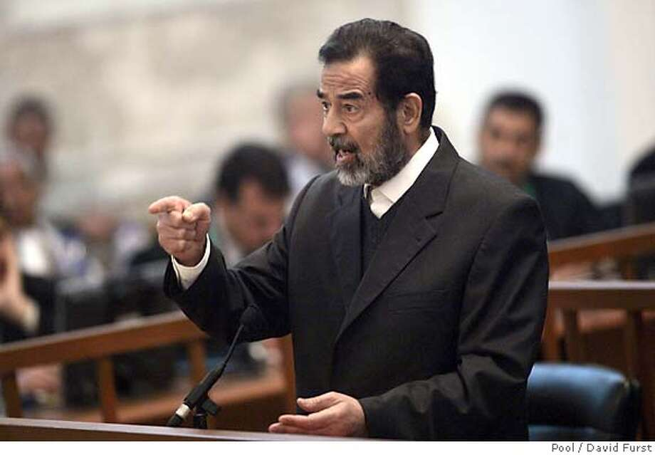 Former Iraqi President Saddam Hussein testifies during cross-examination at his trial held in Baghdad's heavily fortified Green Zone, Wednesday April 5, 2006. Saddam Hussein was cross-examined for the first time in his six-month-old trial Wednesday, saying he approved death sentences against Shiites in the 1980s because he believed the evidence had proven they were involved in an assassination attempt against him. (AP Photo/ David Furst, Pool) Photo: DAVID FURST