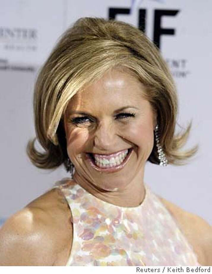Katie Couric, co-host of NBC television network morning program 'The Today Show', smiles during a fundraiser in New York in this March 15, 2006 file photograph. There is intense speculation that Couric is about to jump to rival network CBS and become its evening news anchor. REUTERS/Keith Bedford/Files 0 Photo: KEITH BEDFORD