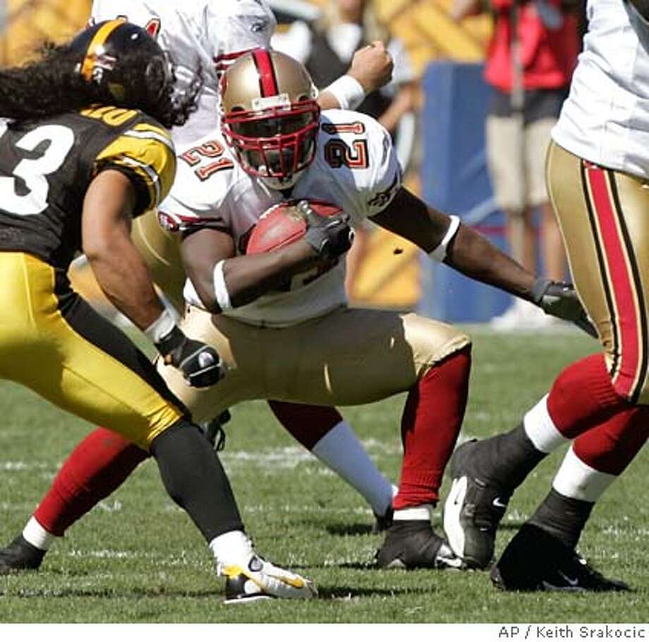 San Francisco 49ers running back Frank Gore (21) runs the ball towrds Pittsburgh Steelers safety Troy Polamalu in the first quarter of the football game in Pittsburgh, Sunday, Sept. 23, 2007. The Steelers won, 37-16. (AP Photo/Keith Srakocic) Photo: Keith Srakocic