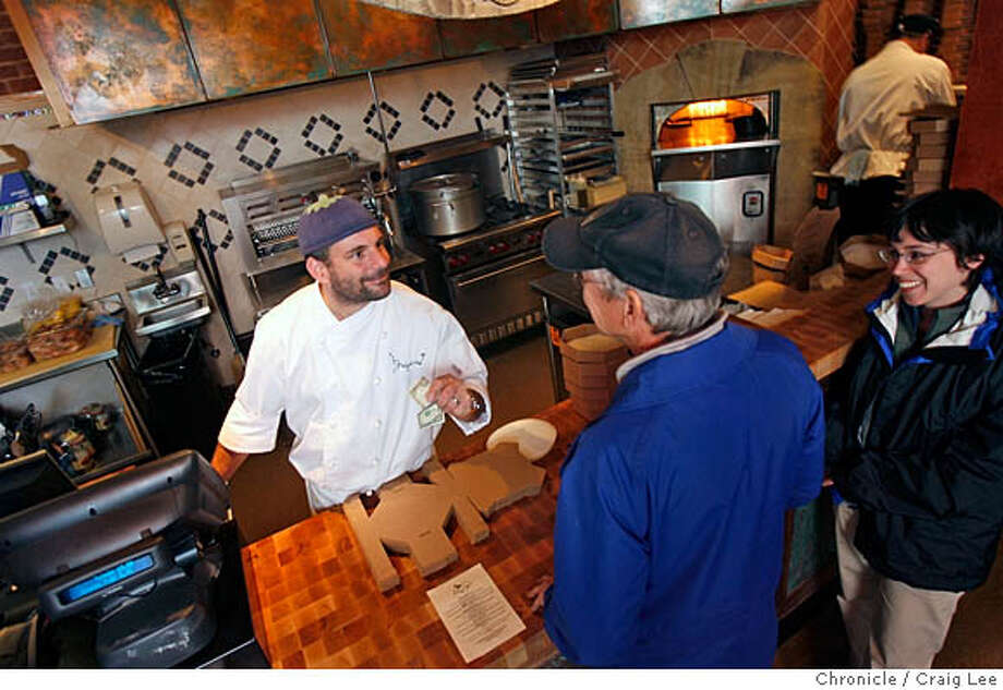 FOODMALL05_085_cl.JPG  Photo of new food malls in the Bay Area. This is Epicurious Garden at 1509 Shattuck in Berkeley. Photo of Gregoire Jacquet, chef and owner of Socca Oven, taking an order from Kevin Sutton and his daughter, Rebecca Sutton.  Craig Lee / The Chronicle MANDATORY CREDIT FOR PHOTOG AND SF CHRONICLE/ -MAGS OUT Photo: Craig Lee
