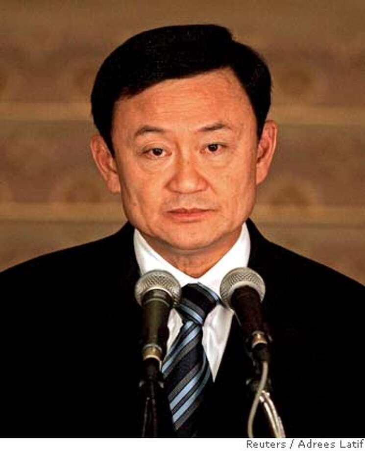 Thai PM Thaksin pauses while addressing the nation at the Government House in Bangkok Photo: ADREES LATIF