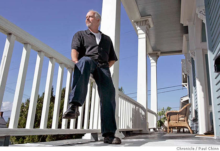 Artist Randall Sexton takes in the view of San Pablo Bay from the front porch of his historic home in Vallejo, Calif. on 3/2/06. Sexton relocated from the North Beach home and studio he'd rented for 23 years and bought a home in Vallejo's Architectural Heritage District, a federally registered historic area with houses ranging in architectural style from Queen Anne to California bungalow.  PAUL CHINN/The Chronicle MANDATORY CREDIT FOR PHOTOG AND S.F. CHRONICLE/ - MAGS OUT Photo: PAUL CHINN