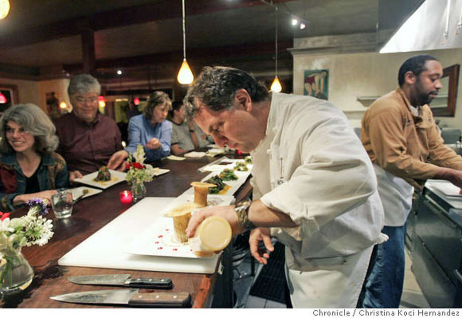 Diners watch as owner-chef Kevin Koebel uses a squeeze bottle to put the finishing touches on a dish. Chronicle photo by Christina Koci Hernandez
