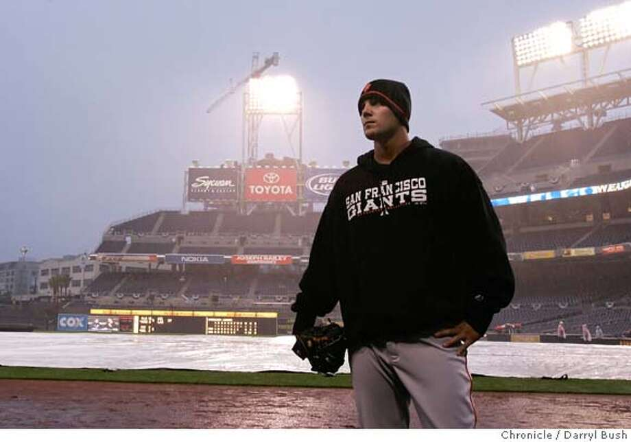 Giants pitcher Noah Lowry looks out from the dugout as rain causes delay at Petco Park. San Francisco Giants vs. San Diego Padres at Petco Park.  Event on 4/4/06 in San Diego.  Darryl Bush / The Chronicle Photo: Darryl Bush