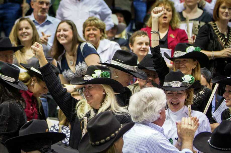 Members of the Champagne Cowgirls celebrate after they made the winning bid on the Grand Champion Steer. Photo: Smiley N. Pool, Houston Chronicle / © 2012  Houston Chronicle