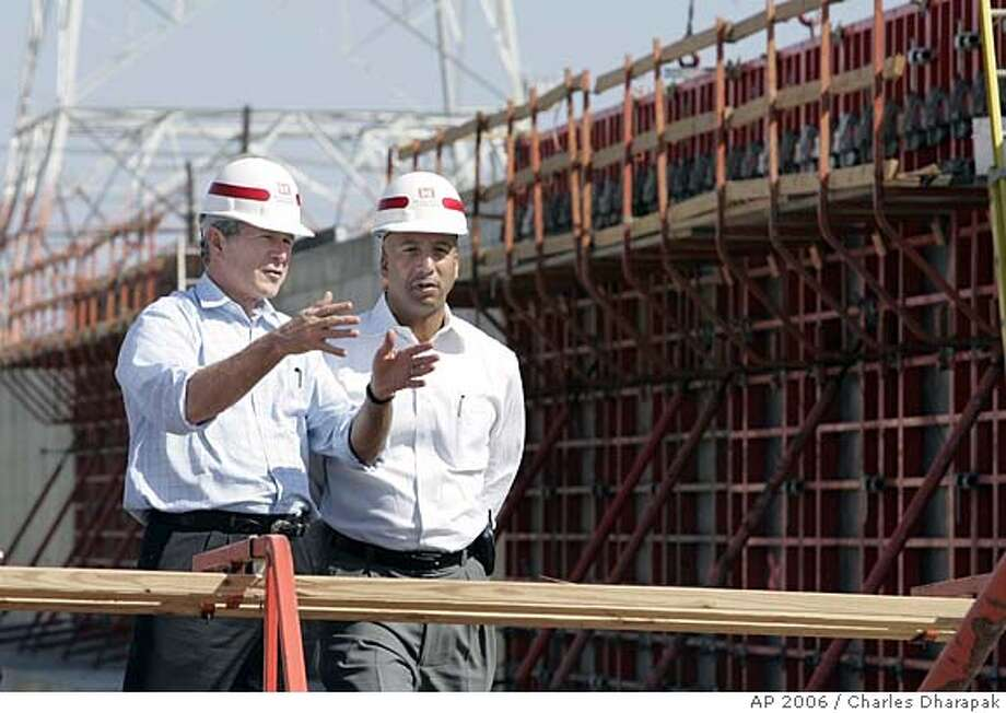 President Bush, left, and New Orleans Mayor Ray Nagin view flood wall construction at the Industrial Canal levee in New Orleans, La., Wednesday, March 8, 2006. Six months after Hurricane Katrina left its mark on the Gulf Coast, President Bush was making his 10th trip to the slowly rebuilding region Wednesday for another progress report. (AP Photo/Charles Dharapak) Photo: CHARLES DHARAPAK