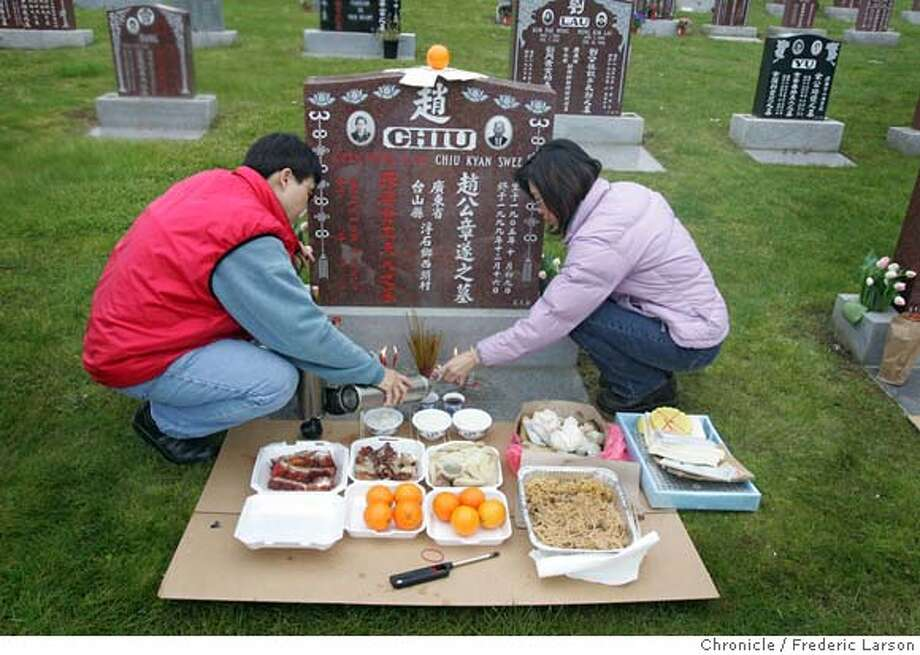 "{object name} Fee Chu (left) of San Mateo the daughter and Helen Wong (grand daughter) prepare a small feast at the grave site of Chiu Kyan Swee who died 1999 at the age of 95. Ching Ming or ""grave sweeping day"" is a traditional time of cemetery visitation for the Chinese culture. The families burn incense, paper and place offerings of food and flowers on the graves. Buddhist nuns also chant blessings at specific times. It falls on April 5 this year, but there will be memorials this weekend. Today, April 2, is the annual Ching Ming Festival for Chinese families at Cypress Lawn, 1370 El Camino Real, Colma. From 11AM to 2PM on both days families come out and pay respect to their deceased loved ones. 4/1/06  Frederic Larson Photo: Frederic Larson"