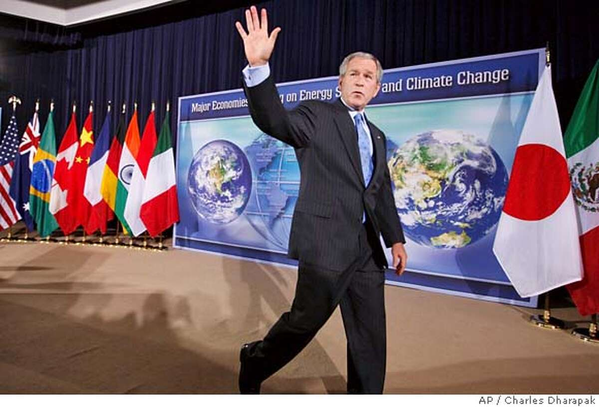 President Bush leaves the stage after speaking at a White House sponsored conference on Energy Security and Climate Change at the State Department in Washington, Friday, Sept. 28, 2007. (AP Photo/Charles Dharapak)