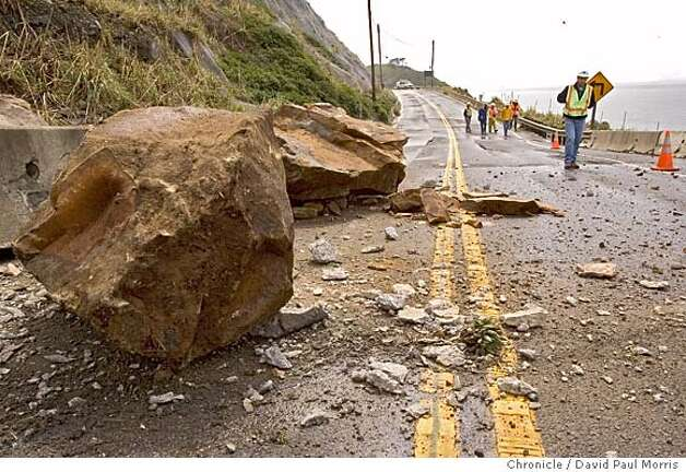 Cal Trans workers look over a recent rock slide along Highway 1 at the Devils Slide area on April 3, 2006 in Pacifica. Photo: David Paul Morris