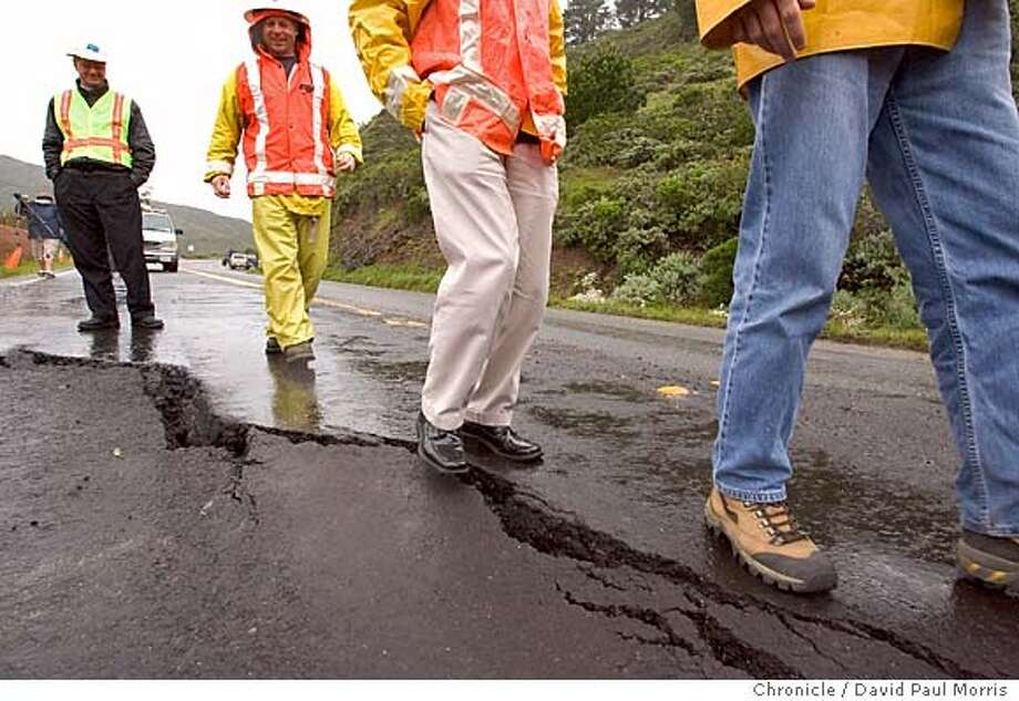 PACIFICA, CALIFORNIA - April 3, 2006 : Cal Trans workers look over a mud slide along Highway 1 at the Devils Slide area on April 3, 2006 in Pacifica, California . Photo by David Paul Morris Photo: David Paul Morris