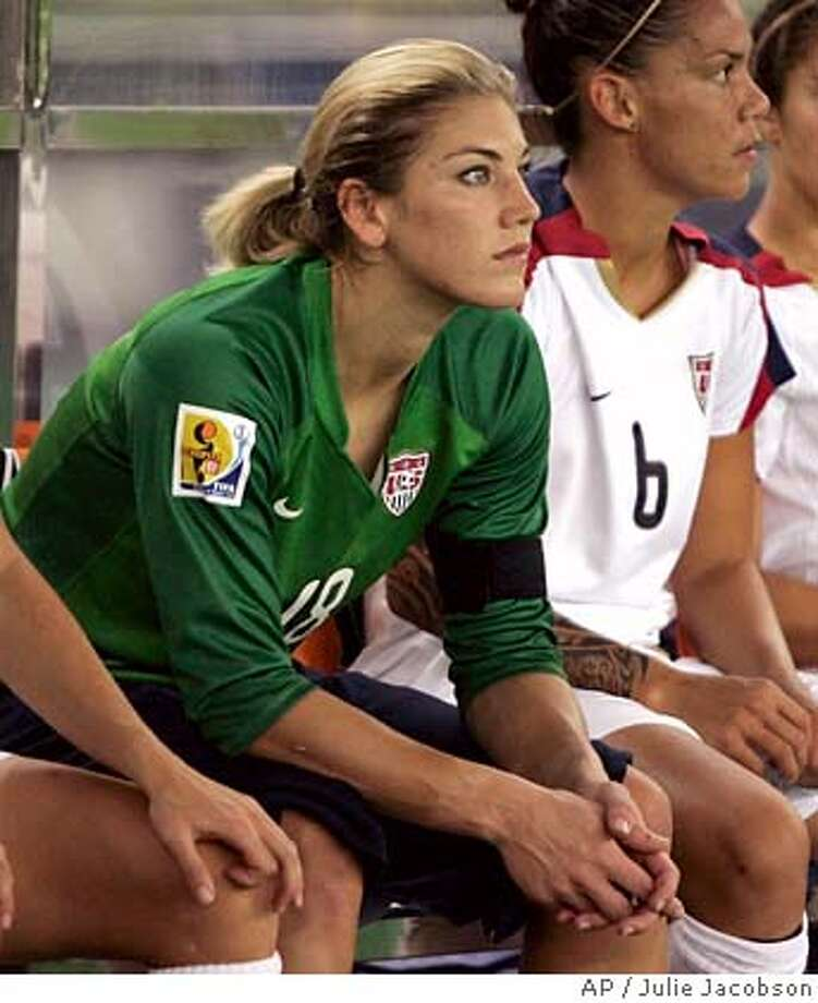 United States women's national team goal keeper Hope Solo sits on the bench before the start of the game against Brazil in the semifinal match of the FIFA 2007 Women's World Cup soccer tournament Thursday, Sept. 27, 2007 in Hangzhou, China. Brazil won 4-0. After the game Solo questioned coach Greg Ryan's decision to start Briana Scurry at goal. (AP Photo/Julie Jacobson) Photo: Julie Jacobson