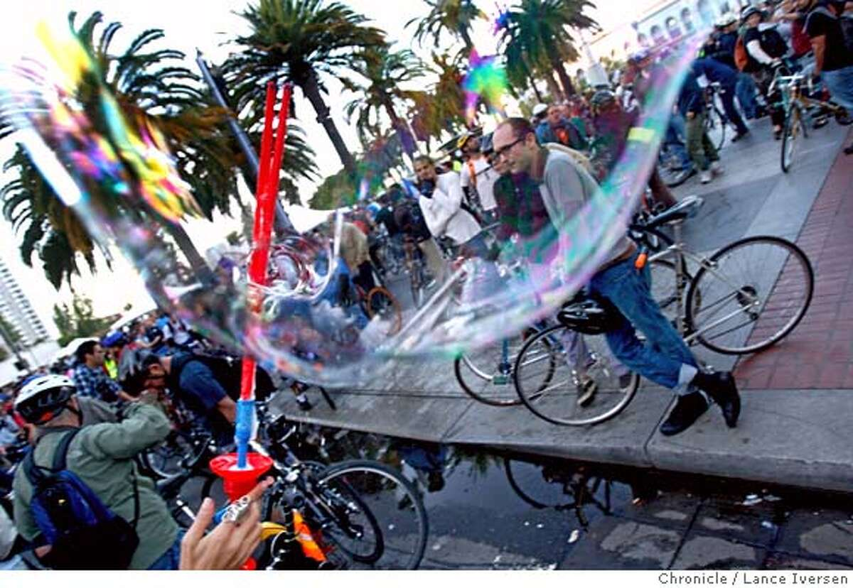CRITICALMASS_69232.JPG Durty D from San Francisco waves her magic wand that makes giant bubbles as Riders wait for the start of the 15th anniversary Critical Mass ride Friday night at Justin Herman Plaza in San Francisco. .SEPTEMBER 28, 2007. Lance Iversen/The Chronicle (cq) Durty D SUBJECT 9/28/07,in SAN FRANCISCO.CA.