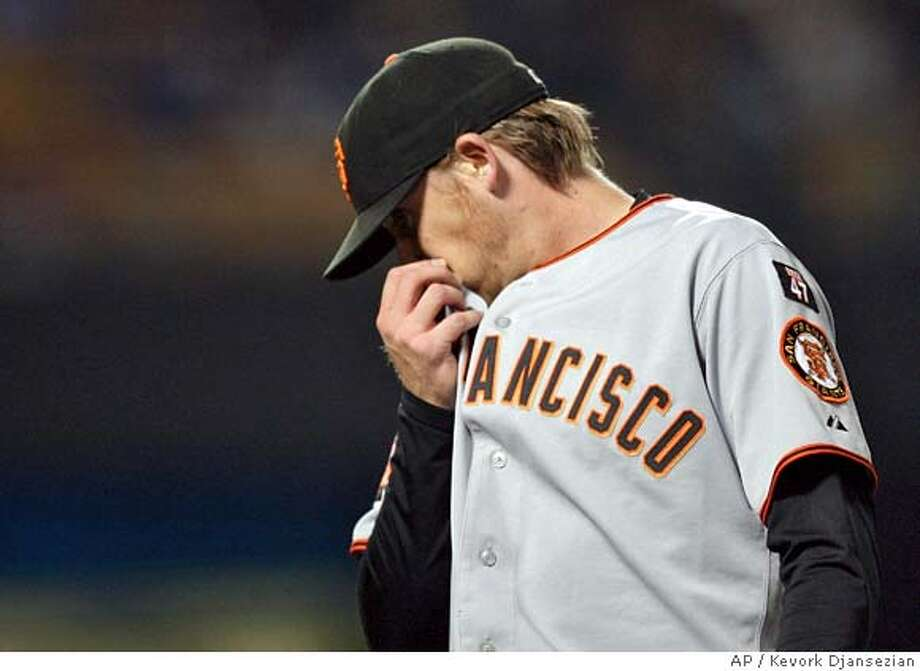 San Francisco Giants pitcher Kevin Correia wipes his face as he walks to the dugout after giving up two runs to Los Angeles Dodgers at the end of the first inning of the baseball game at Dodger Stadium in Los Angeles, Friday, Sept. 28, 2007. (AP Photo/Kevork Djansezian) Photo: Kevork Djansezian