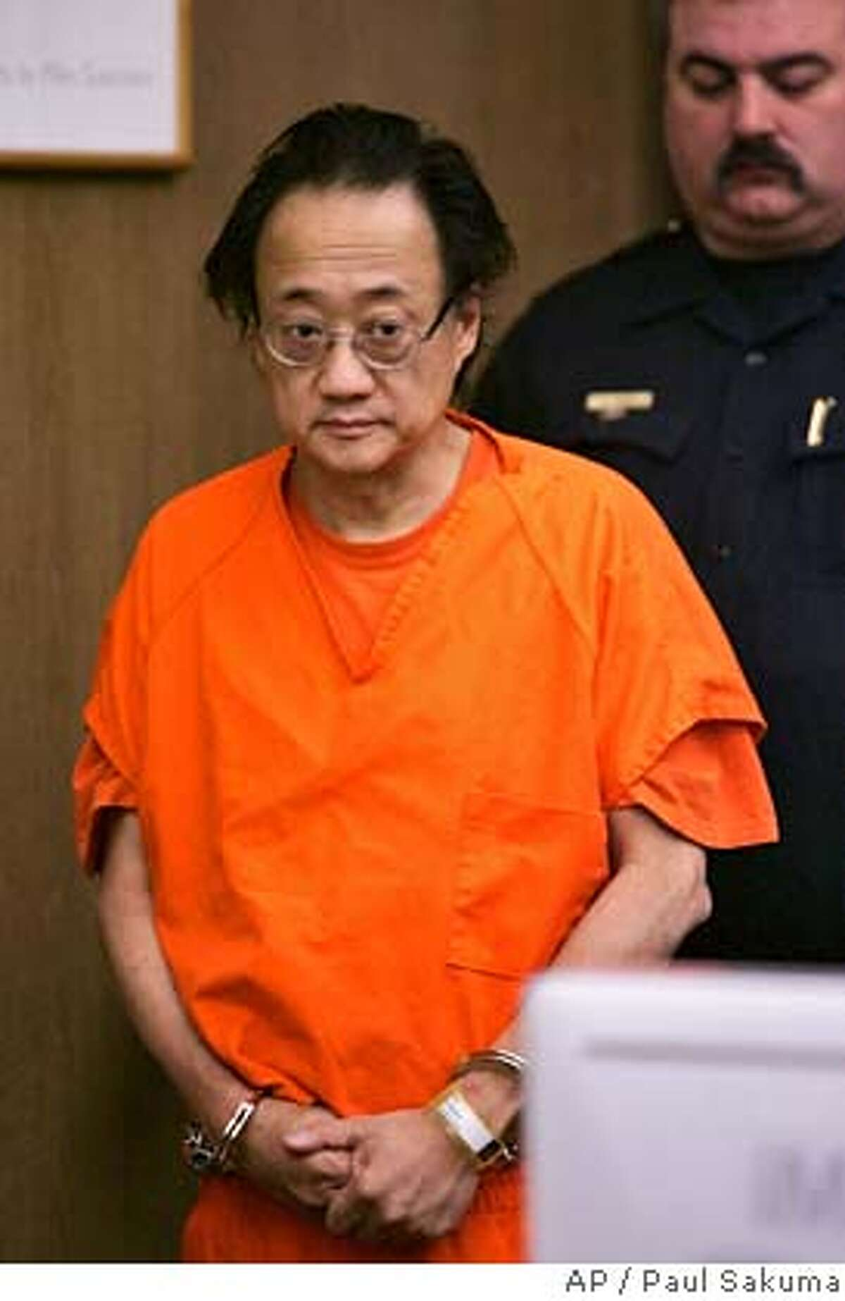 Norman Hsu is escorted into a Redwood City, Calif., courtroom, Friday, Sept. 21, 2007. Jilted investors who sunk $63 million into Hsu's alleged Ponzi schemes are competing for whatever financial crumbs they can shake from the disgraced Democratic fundraiser. At the same time, state and federal prosecutors are wrangling over where he should be jailed. (AP Photo/Paul Sakuma, pool) POOL PHOTO