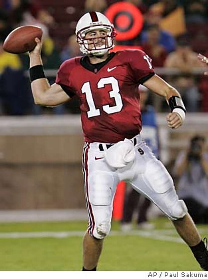 Stanford quarterback T.C. Ostrander (13) passes in front of Oregon defensive end Nick Reed (49) in the second quarter of their NCAA football game, Saturday, Sept. 22, 2007, in Stanford, Calif. (AP Photo/Paul Sakuma) Photo: Paul Sakuma