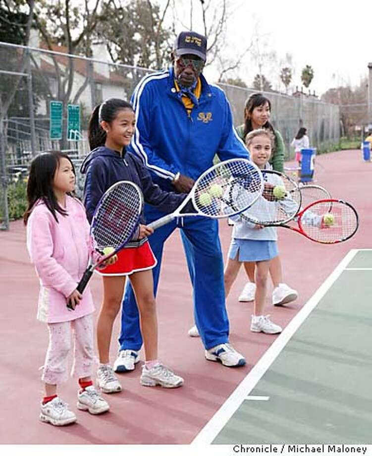 """JA_JOHNSON_043_MJM.jpg  Don Johnson works with kids at a South San Jose tennis court.  Sixty-one-year-old Don Johnson aka """"The Tennis Machine"""" has been volunteering his time teaching tennis at two parks in San Jose. He was a friend and trainer of the late tennis great Arthur Ashe. He is the Jefferson Awards winner for this week.  Photo by Michael Maloney / San Francisco Chronicle on 3/22/06 in San Jose,CA Photo: Michael Maloney"""