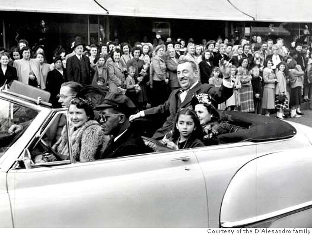 Mayor Thomas D'Alesandro, Jr. in backseet of car with daughter Nancy and wife Nancy. (File photo scanned 11/13/02) Photo from 1948. Courtesy of the D'Alesandro family via the Baltimore Sun.