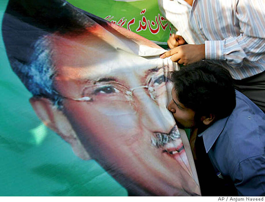 A supporter of Pakistans President Gen. Pervez Musharraf kisses his portrait at a rally to celebrate Supreme Court decision in Islamabad, Pakistan on Friday, Sept. 28, 2007. Pakistan's Supreme Court dismissed legal challenges to Musharraf's bid for a new five-year term. The 6-3 decision in favor of the military leader allows him to contest the Oct. 6 election while army chief and removes the main obstacle to his staying in office. (AP Photo/Anjum Naveed) Photo: Anjum Naveed