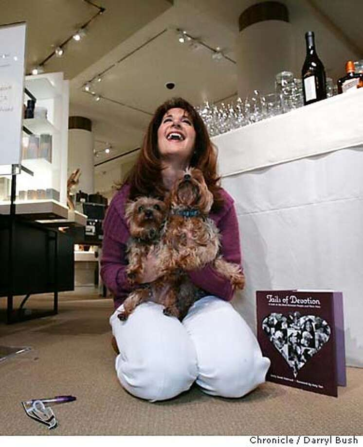 "puppy02_0026_db.JPG  Author of ""Tails of Devotion,"" Emily Scott Pottruck, holds her Yorkshire Terriers, Andy, 9, and Boomer, 8, while she takes a break from signing books inside Gump's. People and their pets arrive to a reception for the book, ""Tails of Devotion: a look at the bond between people and their pets"" at Gump's near Union Square.  Event on 3/22/06 in San Francisco.  Darryl Bush / The Chronicle MANDATORY CREDIT FOR PHOTOG AND SF CHRONICLE/ -MAGS OUT Photo: Darryl Bush"