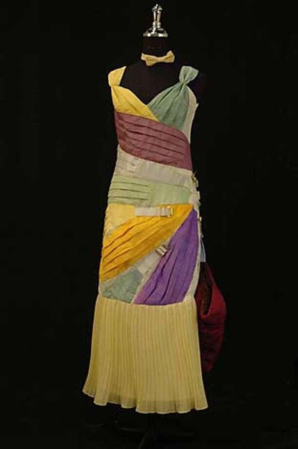 """1) Cummberbund dress Artist: SFSU student Lena Wernet Materials: cummerbunds, hand dyed, hand sewn. Title of piece: """"Evening Dress with Muff: from Masculine to Feminine"""" Photo: Handout"""