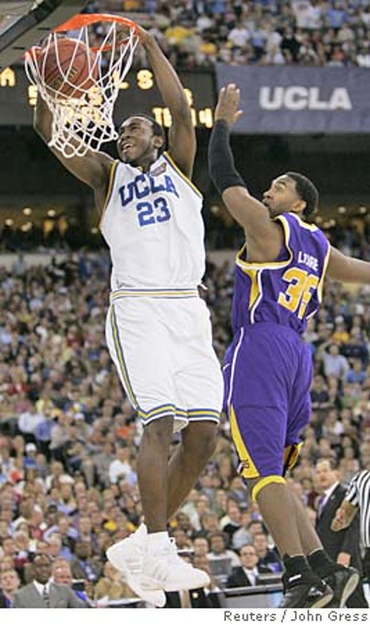 UCLA Bruins' Luc Richard Mbah a Moute (L) dunks the basketball over LSU Tigers' Darnell Lazare (R) during their semi-final basketball game at the men's NCAA Final Four in Indianapolis, April 1, 2006. REUTERS/John GressRan on: 04-02-2006 UCLAs Luc Richard Mbah a Moute shows Darnell Lazare that he was the best big man on the floor.Ran on: 04-02-2006 UCLAs Luc Richard Mbah a Moute shows Darnell Lazare that he was the best big man on the floor.Ran on: 04-02-2006 UCLAs Luc Richard Mbah a Moute shows Darnell Lazare that he was the best big man on the floor.