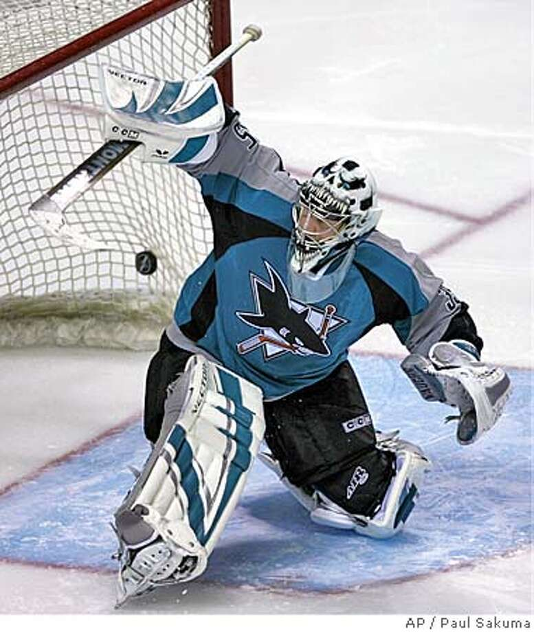 San Jose Sharks goalie Vesa Toskala, of Finland, can't stop a goal by Phoenix Coyotes left wing Geoff Sanderson during the second period of an NHL hockey game, Saturday, April 1, 2006, in San Jose, Calif. (AP Photo/Paul Sakuma) Photo: PAUL SAKUMA