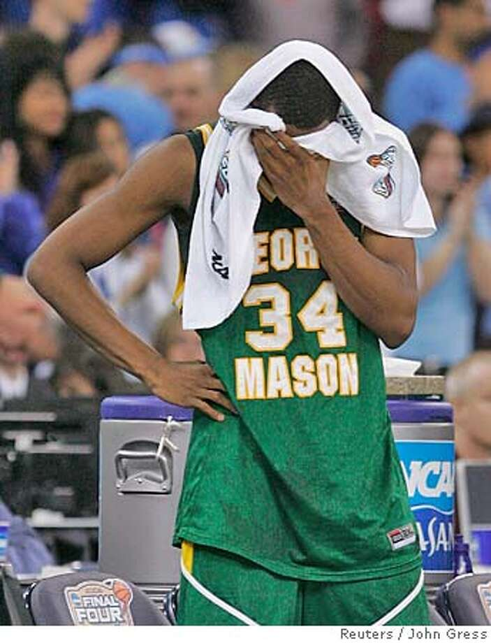 George Mason Patriots' Will Thomas reacts to his team's 73-58 loss to the Florida Gators in their semi-final basketball game at the men's NCAA Final Four in Indianapolis, April 1, 2006. REUTERS/John Gress 0 Photo: JOHN GRESS