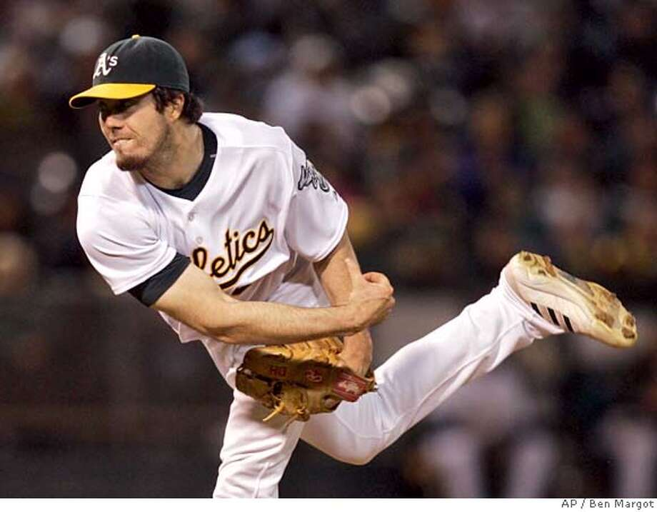 Oakland Athletics' Dan Haren works against the Los Angeles Angels in the first inning of a baseball game Friday, Sept. 28, 2007, in Oakland, Calif. (AP Photo/Ben Margot) Photo: Ben Margot