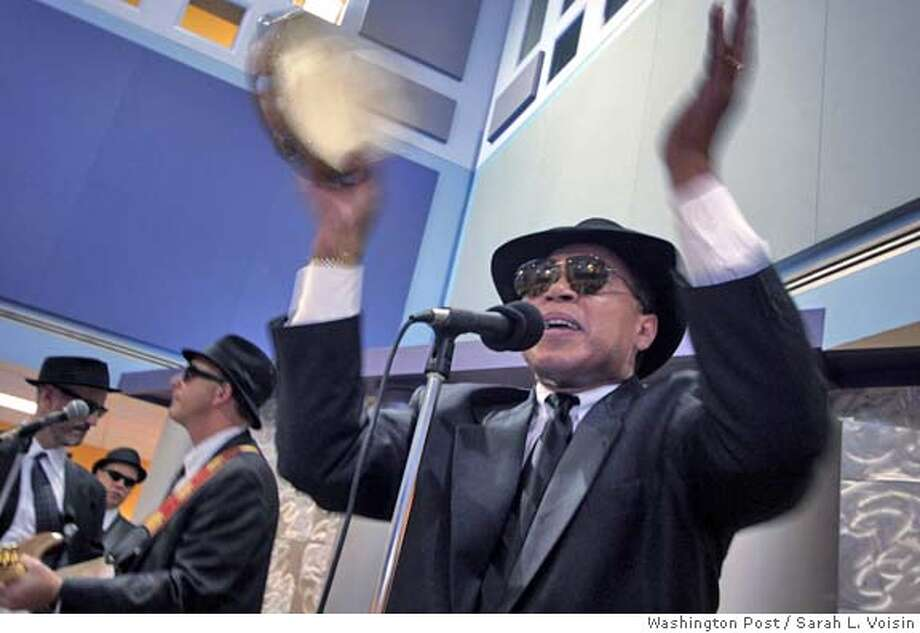 """Judge William """"Dawgg"""" Jackson pounds a beat during a performance by """"Deaf Dog and the Indictments"""" at Children's Hospital in Washington. The band was formed during a judges' retreat last fall and has played at several locations around Washington. Illustrates JUDGEBAND (category a), by Henri Cauvin (c) 2006, The Washington Post. Moved Friday, March 24, 2006. (MUST CREDIT: Washington Post photo by Sarah L. Voisin). Photo: SARAH L. VOISIN"""