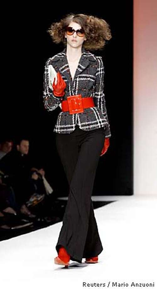 A model walks the runway at the Louis Verdad fashion show of the fall 2006 collection at Smashbox Studios in Culver City, California, March 19, 2006. The Los Angeles fashion week for the fall of 2006 begins on Sunday and lasts for five days. REUTERS/Mario Anzuoni 0 Photo: MARIO ANZUONI
