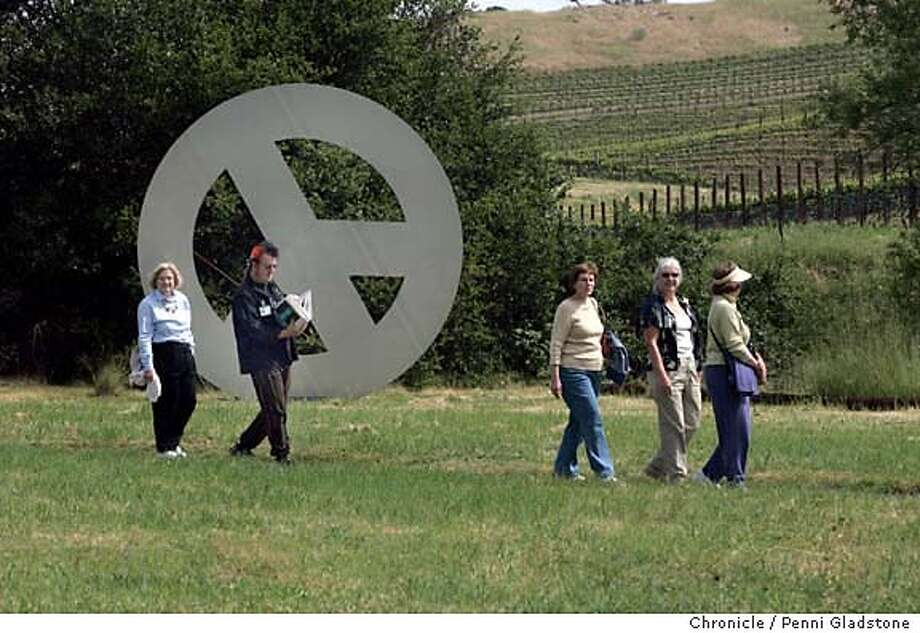 NBFLOWERS20_030_PG.JPG On a tour of the art, these people walk past a vineyard and a peace sign called, Big Peace II made by Tony Labat Di Rosa Preserve in Napa is a stunning natural habitat that features 53 acres of wildlife, including a 35-acre lake, and art. Spring means wildflowers and the preserve is offering hikes through late May, with stunning views of the Carneros region. The San Francisco Chronicle, Penni Gladstone  Photo taken on 4/26/05, in Napa, Ran on: 05-06-2005  Spring wildflowers (clockwise from top left) Pimpernel, also known as Anagallis; Red Clover; Bellardia; and a common European vetch share space with art and peacocks. Photo: Penni Gladstone