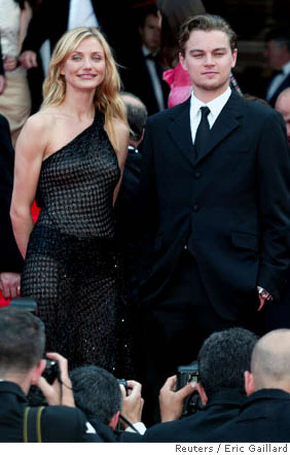 """Cameron Diaz and Leonardo Di Caprio arrive at Cannes for the screening of director Martin Scorsese's film, """"Gangs of New York."""" Reuters file photo, 2002, by Eric Gaillard"""