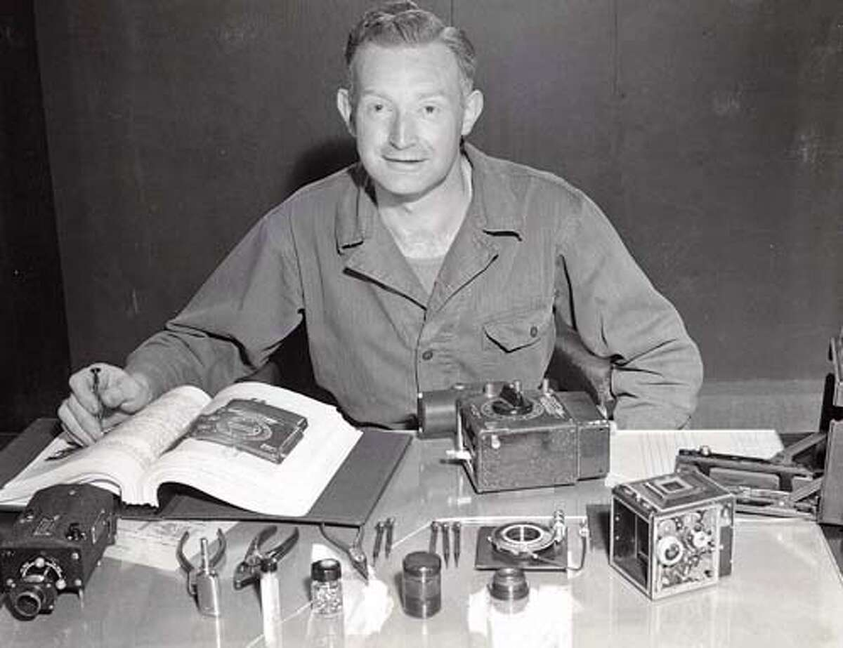 GASSER02.jpg Adolph Gasser, photographed with a timing mechanism and other photography equipment, circa 1943, during his years in the Photo Division of the 509th Composite Group of the Army Air Corps. Gasser was a camera technician for the division and loaded and maintained aerial cameras, including the ones that went on the atomic bomb missions to Hiroshima and Nagasaki. Gasser passed away March 23, 2006 at age 94. He owned Adolph Gasser Photography in San Francisco. Source: John Gasser