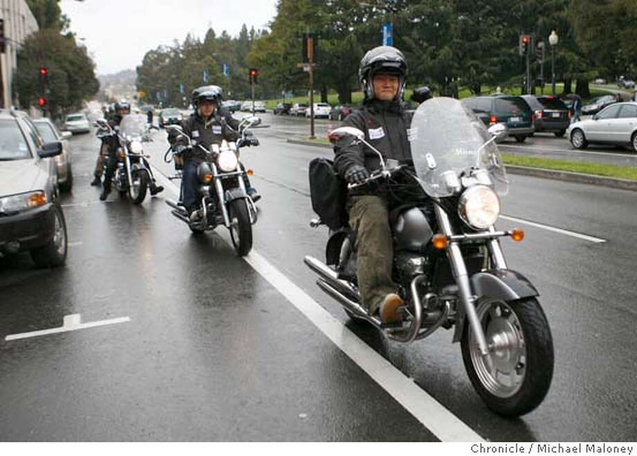 """DOKDO01_022_MJM.jpg  The """"Dokdo Riders"""" head down Oxford Street in Berkeley on their 250cc Korean made motorcycles.  Five guys from South Korea who call themselves the """"Dokdo Riders""""are starting an around-the-world motorcycle tour from the Bay Area to publicize Korea's claim to Dokdo Island, which is perhaps the most inflammatory current issue for Koreans regarding Japan. Japan also lays claim to it, calling it Takeshima. It's basically a large rock, but it's also a symbol of Korean pride and subject of angry Korean demonstrations. Photo by Michael Maloney / San Francisco Chronicle on 3/31/06 in Berkeley,CA MANDATORY CREDIT FOR PHOTOG AND SF CHRONICLE/ -MAGS OUT Photo: Michael Maloney"""