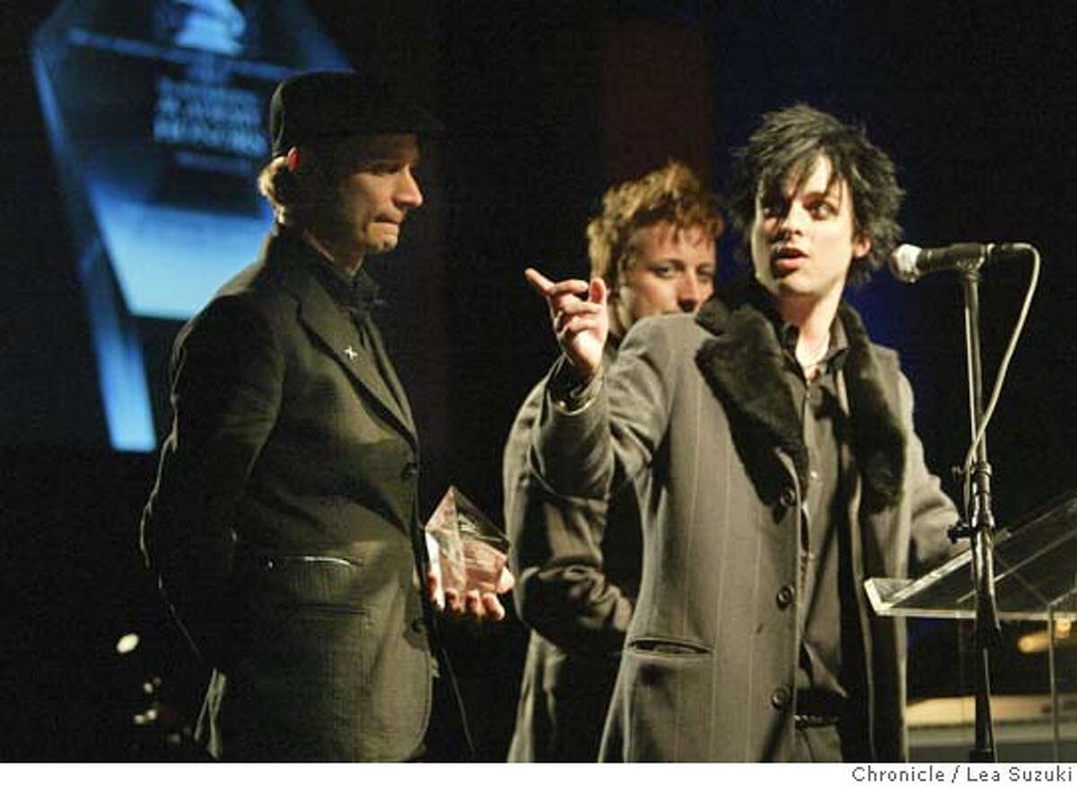 grammy21_087_ls.jpg Green Day (from left: Mike Dirnt, Tre' {accent over the e} Cool and Billie Joe Armstrong) accept their award at the San Francisco Chapter's 2006 Recording Academy Honors. Music luminaries Dave Brubeck,� George Duke, three-time Grammy winners Green Day and the San Francisco Blues Festival have been named as recipients of the San Francisco Chapter's 2006 Recording Academy Honors.�The gala event, which will attract recording artists, key entertainment executives and community leaders, will be held Sunday, March 19, at 6 p.m. in the Grand Ballroom of the historic Westin St. Francis in San Francisco's Union Square. Photo taken on 3/19/06 in San Francisco, CA. Photo by Lea Suzuki/ The San Francisco ChronicleRan on: 03-21-2006 East Bay punk rock trio Green Day accepts a Recording Aca- demy Honors trophy Sunday at the Westin St. Francis Hotel. MANDATORY CREDIT FOR PHOTOG AND SF CHRONICLE/ -MAGS OUT.