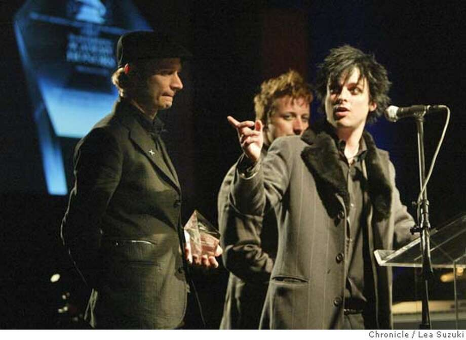 grammy21_087_ls.jpg Green Day (from left: Mike Dirnt, Tre' {accent over the e} Cool and Billie Joe Armstrong) accept their award at the San Francisco Chapter's 2006 Recording Academy Honors. Music luminaries Dave Brubeck,� George Duke, three-time Grammy winners Green Day and the San Francisco Blues Festival have been named as recipients of the San Francisco Chapter's 2006 Recording Academy Honors.�The gala event, which will attract recording artists, key entertainment executives and community leaders, will be held Sunday, March 19, at 6 p.m. in the Grand Ballroom of the historic Westin St. Francis in San Francisco's Union Square.  Photo taken on 3/19/06 in San Francisco, CA. Photo by Lea Suzuki/ The San Francisco ChronicleRan on: 03-21-2006  East Bay punk rock trio Green Day accepts a Recording Aca- demy Honors trophy Sunday at the Westin St. Francis Hotel. MANDATORY CREDIT FOR PHOTOG AND SF CHRONICLE/ -MAGS OUT. Photo: Lea Suzuki