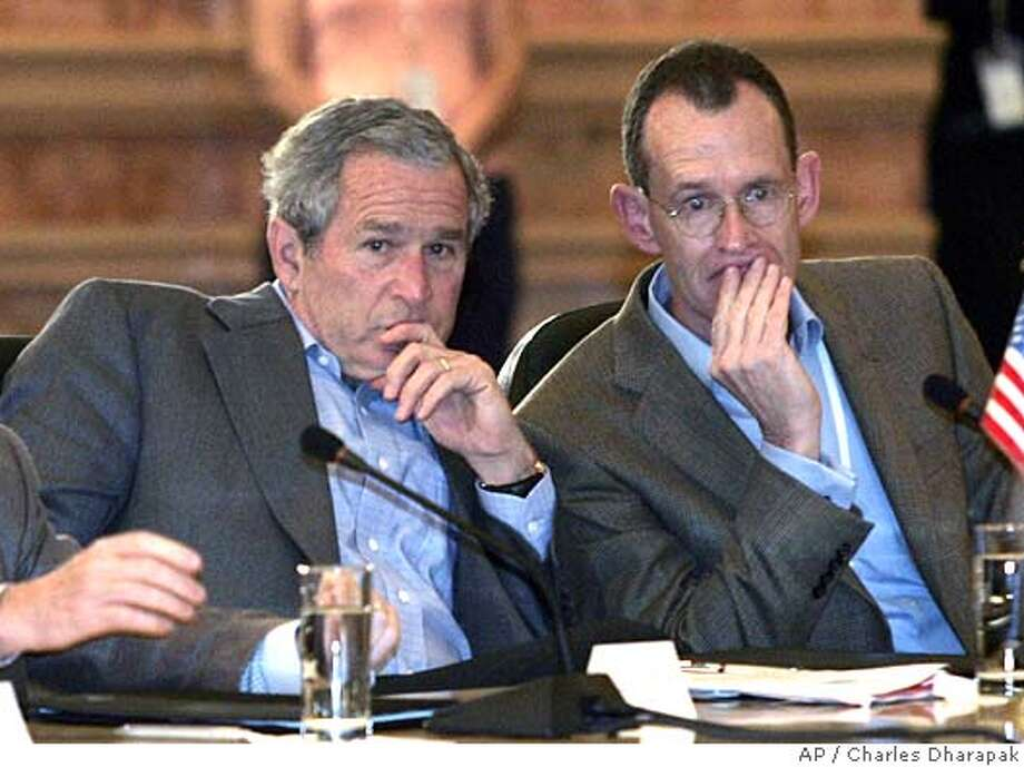 President Bush, left, sits with Robert J. Stevens, president and CEO of Lockeed Martin during a meeting with U.S., Canadian, and Mexican business leaders in Cancun, Mexico, Friday, March 31, 2006. (AP Photo/Charles Dharapak) Photo: CHARLES DHARAPAK