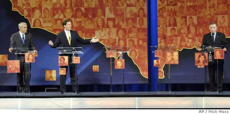 Republican presidential hopefuls from left to right-Rep. Ron Paul,R-Texas, Sen. Sam Brownback,R-Kan., and Rep. Tom Tancredo, R-Colo. at the All-American Presidential Forums program, Thursday, Sept. 27, 2007, in Baltimore. Two empty podiums stand between the hopefuls.(AP Photo/Nick Wass) Photo: Nick Wass
