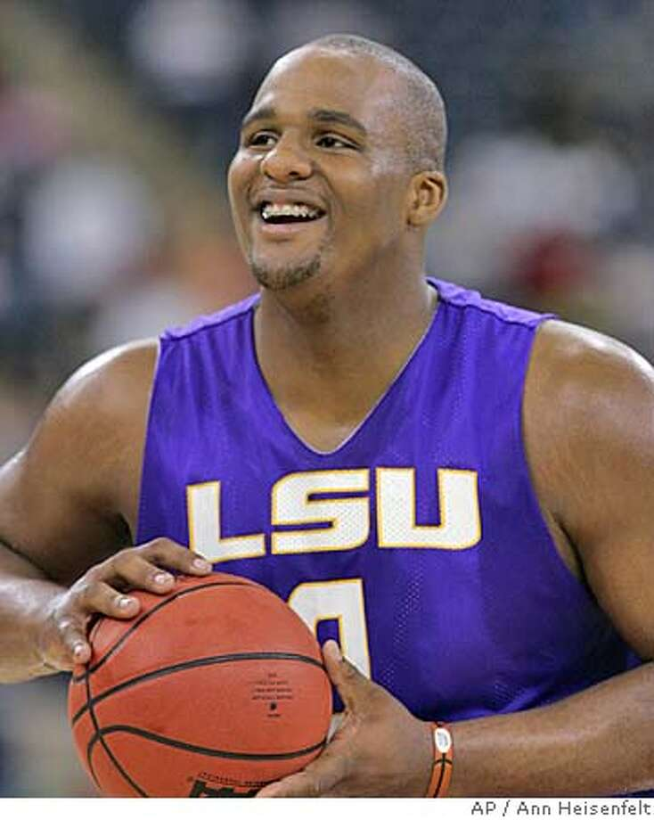 LSU forward Glen Davis gets set to shoot a basket during their practice session Friday, March 31, 2006, in Indianapolis. The Tigers face UCLA in a semifinal game in the NCAA Final Four on Saturday. (AP Photo/Ann Heisenfelt) Photo: ANN HEISENFELT