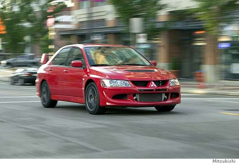 (NNS6-APR15) The 2005 Mitsubishi Lancer Evolution MR is engineered to go fast in either a straight line or around corners, but without a thought for passenger comfort. SEE ``MITSUBISHI-LANCER'' (Newhouse), transmitted April 15.Ran on: 04-01-2006  The Mitsubishi Lancer Evolution MR, 2005 model shown here, is ugly and fast -- rather like a rocket-powered groundhog or a baby hippo fired out of a cannon.Ran on: 04-01-2006  Ran on: 04-01-2006  Ran on: 04-01-2006 Photo: Mitsubishi