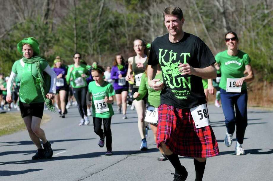 Chuch DiPace of Guilderland, right, dons a kilt as he runs 4 kilometers in the 1st Annual St. Patrick's Day Kilt Run on Saturday, March 17, 2012, in Averill Park, N.Y. (Cindy Schultz / Times Union) Photo: Cindy Schultz / 00016417A