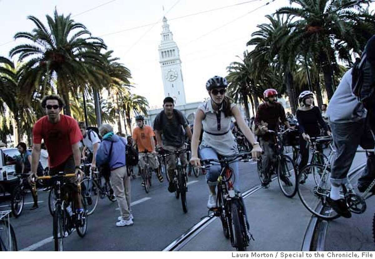 CRITICALMASS31_0059_LKM.jpg Critical Mass riders make their way up Market Street at the start of Friday night's ride in San Francisco, CA. (Laura Morton/Special to the Chronicle)