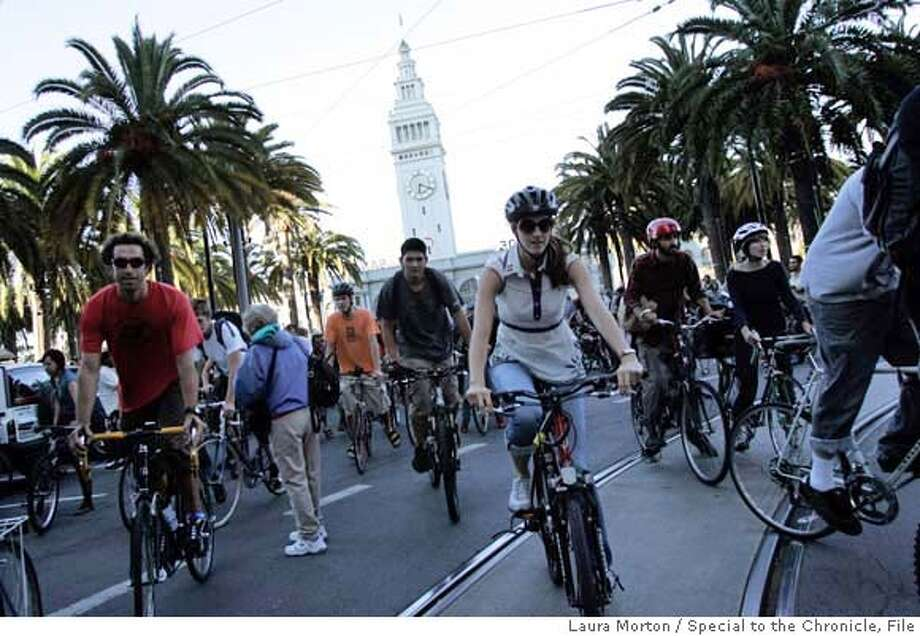 CRITICALMASS31_0059_LKM.jpg Critical Mass riders make their way up Market Street at the start of Friday night's ride in San Francisco, CA. (Laura Morton/Special to the Chronicle) Photo: Laura Morton