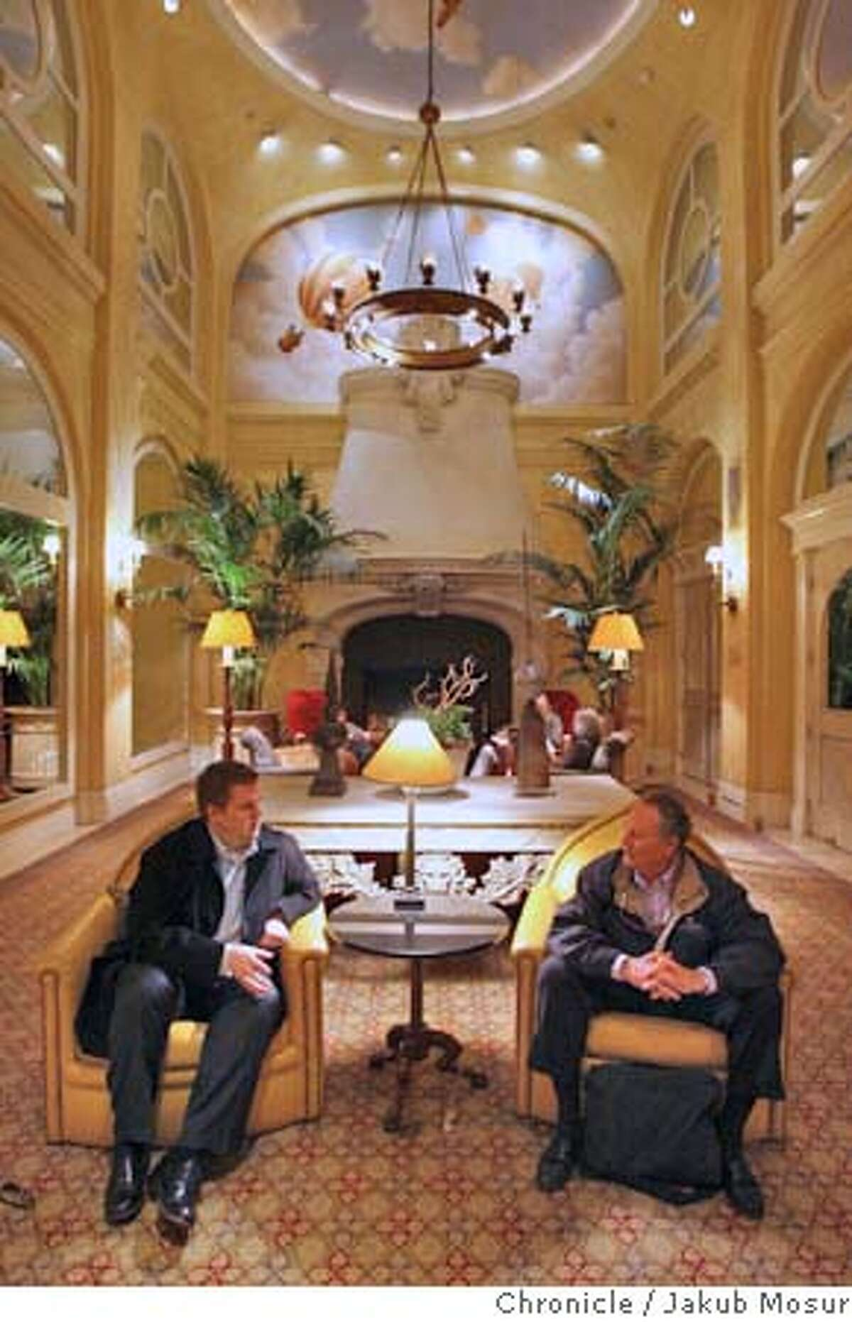 Kimpton28_03_JMM.JPG Ian Itschner, of Portland, Oregon, and Larry Hartman, of Brentwood, talk in the lobby of the Hotel Monaco, owned by the Kimpton Group. The San Francisco based Kimpton Group, which has 40 hotels around the country now, plans to double its holdings to 80 hotels in the next 5 years, financed by deep-pockets private investors and lifted by a recovering hotel and travel market. Event on 3/24/06 in San Francisco. JAKUB MOSUR / The Chronicle MANDATORY CREDIT FOR PHOTOG AND SF CHRONICLE/ -MAGS OUT