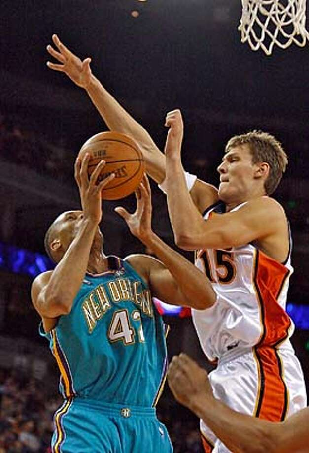 Andris Biedrins is all over P.J.Brown under the basket during the second quarter.  Golden State Warriors vs NO/Okla City Hornets Kurt Rogers Oakland SFC  The Chronicle WARRIORS_00247_kr.JPG MANDATORY CREDIT FOR PHOTOG AND SF CHRONICLE/ -MAGS OUT Photo: Kurt Rogers