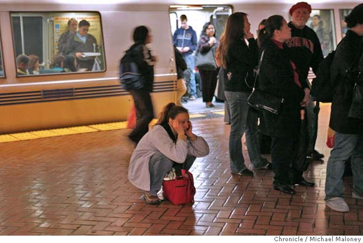 BART_020_MJM.jpg Allyn Hall of Emeryville calls her husband for a ride after BART announced there was a system wide shut down. She was in the Powell Street BART station hoping for an eastbound train. The train in the background was stopped. BART experienced a 90-minute shutdown caused by a computer networking problem during the height of the evening commute Wednesday. BART stopped regular service after the problem hit at 5:27 p.m., moving all trains under manual control to the nearest station. System officials said trains had resumed about 6:50 p.m. BART spokesman Linton Johnson said the problem was different from the software glitch that plagued the system Tuesday, but had the same effect -- a service shutdown. Photo by Michael Maloney / San Francisco Chronicle on 3/29/06 in San Francisco,CARan on: 03-30-2006 Darren M. Kelly, an architect in San Francisco who lives in Lafayette, looks for a train at BARTs Powell Street Station.