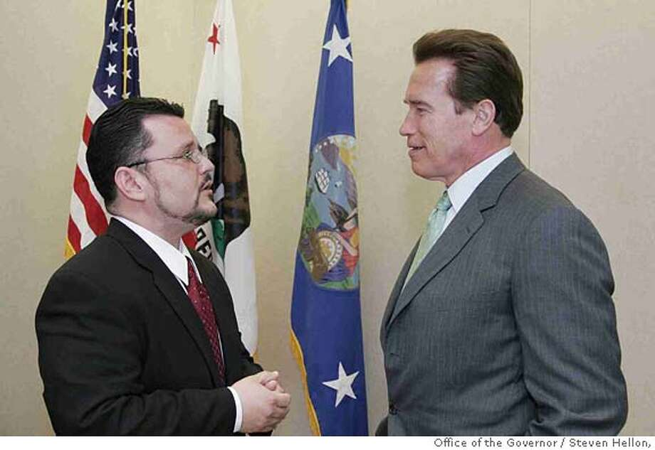 Photo of Governor Schwarzenegger and Hector Ramirez, Chair of the California Children and Families Commission. Photo credit: Steven Hellon, Office of the Governor Photo: Steven Hellon, Office Of The Gov