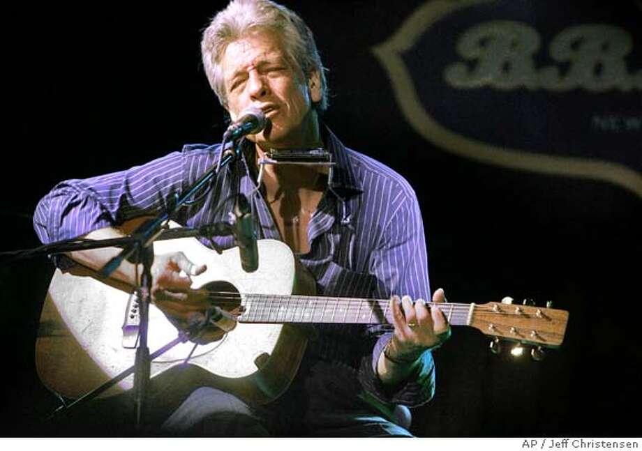 Legendary musician John Hammond performs at B.B. Kings Blues Club in New York, Monday, Sept. 26, 2005. (AP Photo/Jeff Christensen) Photo: JEFF CHRISTENSEN
