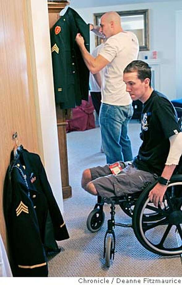 {filename}  Brent takes a look at his uniform before getting dressed for the Battalion Ball. He is with his buddies, including Kevin Kryder, from Charley Company who have just returned from Iraq. Brent Bretz, a soldier who was seriously injured by an IED (improvised explosive device) in Iraq in December of 2004 met the soldiers he served with from company Charley when they came home from Iraq to Fort Lewis, Washington.  Event was shot on {date} in {city}.  San Francisco Chronicle photo by Deanne Fitzmaurice Photo: Deanne Fitzmaurice