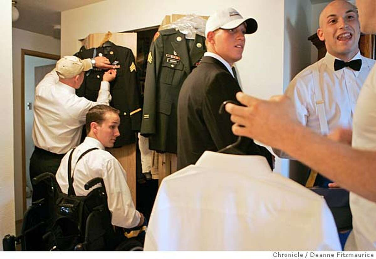 Brent is surrounded by his comrades from Charley Company (center in baseball cap, Kyle Nactrieb and Kevin Kryder at right) as they get ready for the Batallion Ball. Brent Bretz, a soldier who was seriously injured by an IED (improvised explosive device) in Iraq in December of 2004 met the soldiers he served with from company Charley when they came home from Iraq to Fort Lewis, Washington. Event in Tacoma on 10/21/05. Deanne Fitzmaurice / The Chronicle